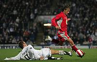 Photo: Paul Thomas.<br /> Blackburn Rovers v Basle. UEFA Cup. 02/11/2006.<br /> <br /> Blackburn's Tugay (Red) gets past the sliding tackle of Ivan Rakitic.
