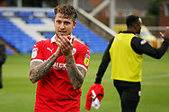 Barnsley midfielder George Moncur (10) claps the fans after  the EFL Sky Bet League 1 match between Peterborough United and Barnsley at The Abax Stadium, Peterborough, England on 6 October 2018.