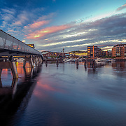 """Verftsbrua (Norwegian for """"Yard Bridge""""), also popularly called Blomsterbrua (""""Flower Bridge"""") is a bridge at the bay of Trondheim. The bridge, built in 2003, spans 125 metres. The name Verftsbrua comes from the nearby shipyard, Trondhjems mekaniske Værksted, while the name Blomsterbrua is due to the bridge being covered with many different kinds of coloured flowers.Please feel free to check my photos here or find me by:  Website  ,"""