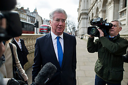 © Licensed to London News Pictures. 20/02/2016. London, UK. MICHAEL FALON MP being questioned by television crews as he arrives at downing street for a cabinet meeting the day after David Cameron finalised negotiations over Britain's membership of the EU. Photo credit: Ben Cawthra/LNP