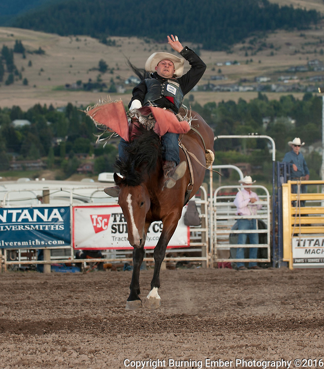 Jessy Davis rides for 84 points on Sankey Pro Rodeo bucking horse Sozo at the Western Montana Fair PRCA Rodeo in Missoula MT August 12th 2016 2nd perf.  Josh Homer photo.  Photo credit must be given on all uses.  www.burningemberphotography.com