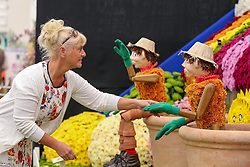 © Licensed to London News Pictures. 20/05/2019. London, UK.  A woman puts finishing touches to Bill and Ben - the Flower Pot Men.<br /> The Royal Horticultural Society Chelsea Flower Show is an annual garden show held over five days in the grounds of the Royal Hospital Chelsea in West London. The show is open to the public from 21 May until 25 May 2019. Photo credit: Dinendra Haria/LNP