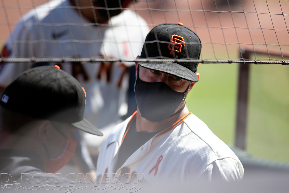 San Francisco Giants manager Gabe Kapler confers with his staff during the fifth inning of a baseball game against the Los Angeles Dodgers on Thursday, Aug. 27, 2020 in San Francisco, Calif. (D. Ross Cameron/SF Chronicle)