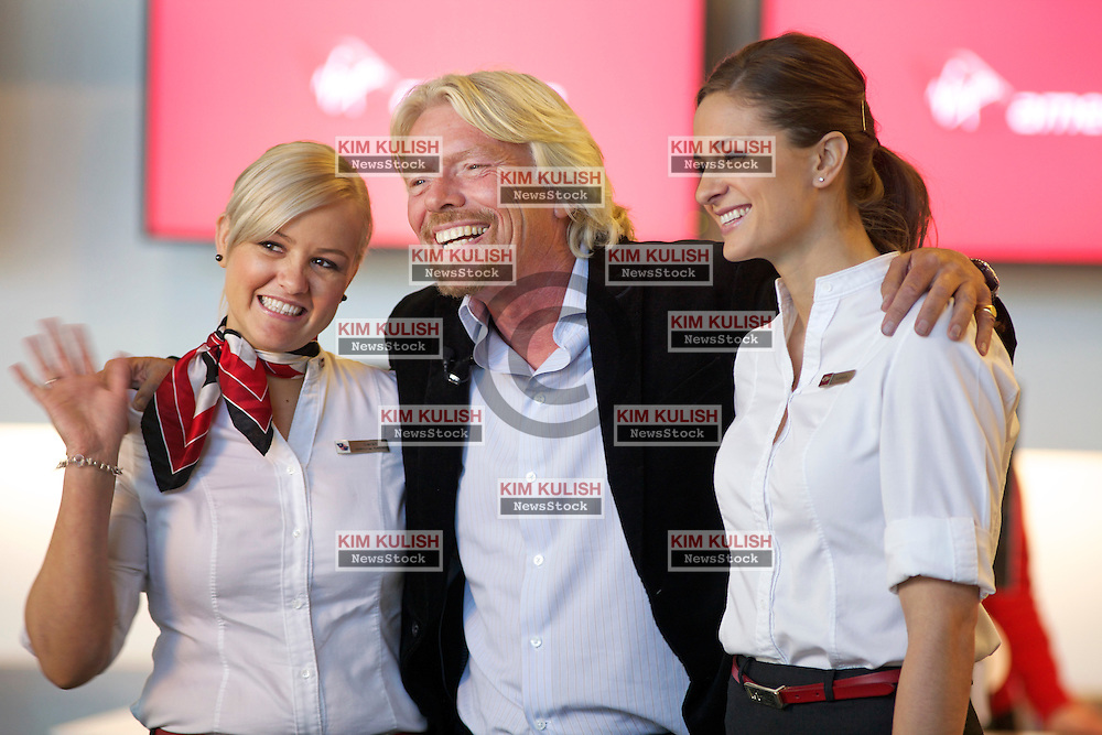Virgin Group Founder Sir Richard Branson,(C), talks with reporters near the Virgin America gates in the new Terminal 2 at San Francisco International Airport.  The 640,000- square-foot Terminal is expected to be the first LEED Gold-certified terminal in the U.S.