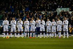 Leeds players join in a minutes applause in memory of former Leeds United chairman Leslie Silver who passed away on 29th December 2014 - Photo mandatory by-line: Rogan Thomson/JMP - 07966 386802 - 20/01/2015 - SPORT - FOOTBALL - Leeds, England - Elland Road Stadium - Leeds United v Bournemouth - Sky Bet Championship.