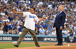 October 25, 2017 - Los Angeles, California, U.S. - Former Los Angeles Dodgers great Fernando Valenzuela throws out the ceremonial pitch as Hall of Fame announcer Vin Scully looks on prior to game two of a World Series baseball game against the Houston Astros at Dodger Stadium on Wednesday, Oct. 25, 2017 in Los Angeles. (Photo by Keith Birmingham, Pasadena Star-News/SCNG) (Credit Image: © San Gabriel Valley Tribune via ZUMA Wire)