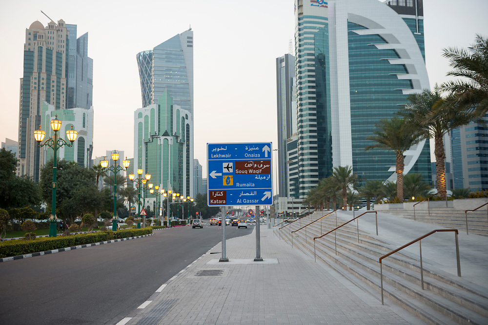 A road sign points directions to various locations in the city of Doha, Qatar.