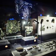 One of the highlights of the National Archaeological Museum in Athens, Greece, the Antikythera Mechanism now has its own dedicated exhibit gallery in which all of its fragments are on display. Believed to date to somewhere around 100 BC to 205 BC, it was found amongst a large cache of statues, coins, and other artefacts on a sunken shipwreck discovered in 1900 by sponge divers off the coast of the Greek island of Antikythera. It was badly damaged after such a long time in the salt water, but extensive research in recent decades has resulted in a consensus that it is a kind of astronomical analog computer as well as some modern reconstructions. The largest piece, with the circular gear clearly visible, is known as Fragment A and contains most of the Mechanism's gears.