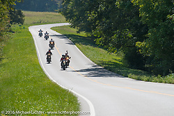 Cannonballers riding in a pack during Stage 5 of the Motorcycle Cannonball Cross-Country Endurance Run, which on this day ran from Clarksville, TN to Cape Girardeau, MO., USA. Tuesday, September 9, 2014.  Photography ©2014 Michael Lichter.