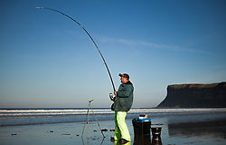 © Licensed to London News Pictures. <br /> 12/10/2014. <br /> <br /> Saltburn, United Kingdom<br /> <br /> A fisherman from takes part in the annual Jim Maidens memorial beach fishing competition in Saltburn by the Sea in Cleveland. <br /> The competition is held each year to mark the death of Saltburn plumber and keen fisherman Jim Maidens who died in 1998 when he was killed after being swept overboard from his boat 'Corina' close to the beach at Saltburn.<br /> <br /> Photo credit : Ian Forsyth/LNP