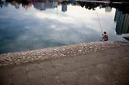 Vietnamese man fishes in Giang Vo lake, Hanoi, Vietnam, Southeast Asia