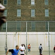 With space at a premium in the vast metropolis of Manhattan, New York City, locals find ways and means for pastime exercise and recreational activities as they go about their daily lives.The basketball courts on the corner of West 4th Street on May 4, 2004. Photo Tim Clayton.
