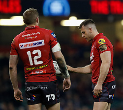 Scarlets' Gareth Davies with team-mate  Scarlets' Hadleigh Parkes<br /> <br /> Photographer Simon King/Replay Images<br /> <br /> Guinness PRO14 Round 21 - Dragons v Scarlets - Saturday 28th April 2018 - Principality Stadium - Cardiff<br /> <br /> World Copyright © Replay Images . All rights reserved. info@replayimages.co.uk - http://replayimages.co.uk