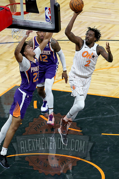 ORLANDO, FL - MARCH 24: Al-Farouq Aminu #2 of the Orlando Magic attempts a shot over Cameron Johnson #23 of the Phoenix Suns and Torrey Craig #12 of the Phoenix Suns during the second half at Amway Center on March 24, 2021 in Orlando, Florida. NOTE TO USER: User expressly acknowledges and agrees that, by downloading and or using this photograph, User is consenting to the terms and conditions of the Getty Images License Agreement. (Photo by Alex Menendez/Getty Images)*** Local Caption *** Al-Farouq Aminu; Cameron Johnson; Torrey Craig