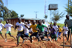 © Licensed to London News Pictures. 02/02/2014. Iten, Kenya. Running in Africa feature. Children take part in a local race. Photo credit : Mike King/LNP