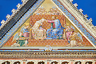 """Close up of the """"Coronation of the Virgin Mary"""" osaic  in the topmost gable created between 1350 and 1390 after designs by artist Cesare Nebbia. on the14th century Tuscan Gothic style facade of the Cathedral of Orvieto, Umbria, Italy"""