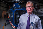 Robert E. O'Connor, MD, MPH, Professor and Chair, Department of Emergency Medicine at The University of Virginia in front of UVA's Pegasus Helicopter at Charlottesville Regional Airport. O'Connor is an alumni of Haverford College. Photo by Justin Ide