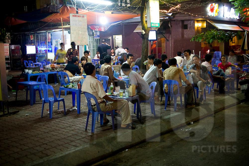 Locals enjoying beer and street food along Tran Huy Lieu street, Hanoi, Vietnam, Southeast Asia