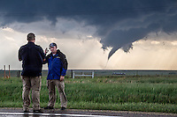 A Weather nation meteorologist delivers a live on-camera report of developing tornado near Dodge City, Kansas, May 24, 2016.