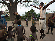Hadza dancing at night, to celebrate a successful hunt. The Hadza camp of Senkele.
