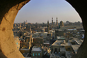 Old Islamic Cairo framed through a minaret tower window. Cairo, Egypt.