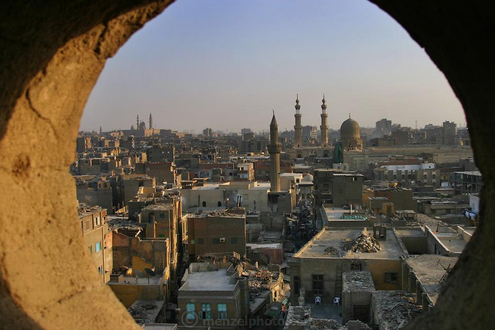 Old Islamic Cairo framed through a minaret tower window. Cairo, Egypt.