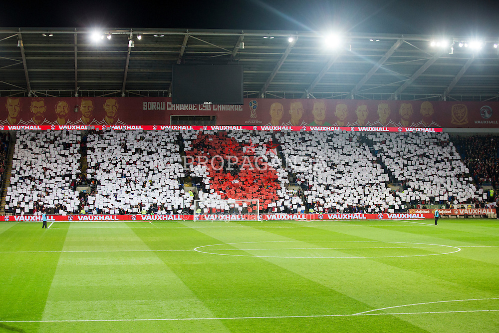 CARDIFF, WALES - Saturday, November 12, 2016: Wales' supporters hold up a mosaic in the design of a Poppy ahead of the 2018 FIFA World Cup Qualifying Group D match against Serbia at the Cardiff City Stadium. (Pic by David Rawcliffe/Propaganda)