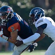 Orange Coast Pirate wide receiver Joey Cox (2) is tackled by Fullerton Hornet defensive back Deryck Fletcher (22).<br /> Cal State Fullerton  Football vs. Orange Coast College College on Saturday, November 5, 2016 at LeBard Stadium in Costa Mesa, CA.  © photo by Annette Wilkerson/Sports Shooter Academy