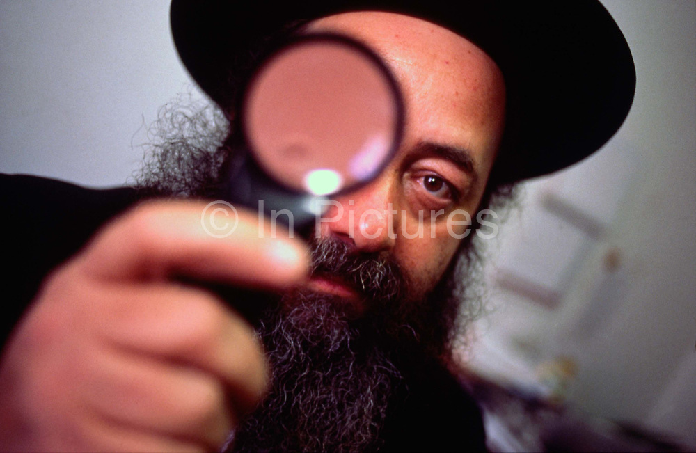 Yehuda Gordon, a Jerusalem based Rabbi that is charged by the Rabbinical courts to trace errant husbands that refuse to divorce their wives and so deny them access to the their rights under Jewish law. Gordon is seen here researching a husband at the Rabbinical court