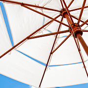 Canvas beach umbrellas providing shade by the pool at La Casa Que Canta, Zihuatanejo, Mexico
