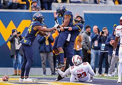 Nov 9, 2019; Morgantown, WV, USA; West Virginia Mountaineers running back Kennedy McKoy (6) celebrates with West Virginia Mountaineers quarterback Austin Kendall (12) after a touchdown during the second quarter during the second quarter against the Texas Tech Red Raiders at Mountaineer Field at Milan Puskar Stadium. Mandatory Credit: Ben Queen-USA TODAY Sports