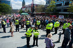 An EDL organised event to lay flowers at Sheffields War Memorial in Barkers Pool in Memory of Lee Rigby on Saturday afternoon was stopped when supporters of Sheffield Unite Against Fascism and One Sheffield Many Cultures occupied the square surrounding the War Memorial preventing EDL supporters from reaching it and laying their flowers  <br /> <br /> 1 June 2013<br /> Image © Paul David Drabble<br /> www.pauldaviddrabble.co.uk