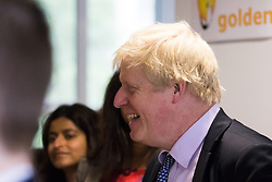 Michaela Community School, Wembley, London, June 23rd 2015. Mayor of London Boris Johnson visits the Michaela Community School, a Free School in Wembley that started taking students in September2014 after battling a certain amount of resistance from locals and unions. During the visit Head Teacher Katharine Birbalsingh took the Mayor on a tour of the school before he participated in a history lesson, prior to sitting down with pupils for brunch. PICTURED: The Mayor shares a joke with pupils before sitting down with them for brunch.