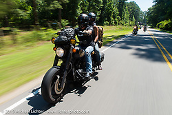 """Newlyweds and coast-to-coast """"Stampeders"""" Jennifer Cushing Portrait and Peter Ford takes a ride Saturday morning during the Smokeout. Rockingham, NC. USA. June 20, 2015.  Photography ©2015 Michael Lichter."""