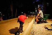 A night time game of Croatian Buce (Bocce). Makarska, Croatia