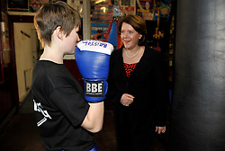 © Licensed to London News Pictures. 19/02/2013. Bristol, UK. Maria Miller (right), the Secretary of State for Culture Media and Sport, watches Natalie Craig age 14 training, on a visit to the Empire Boxing Club in St Pauls, Bristol.  The Secretary of State is keen to build on the momentum of the Olympics and get more girls and women playing sport.  19 February 2013..Photo credit : Simon Chapman/LNP