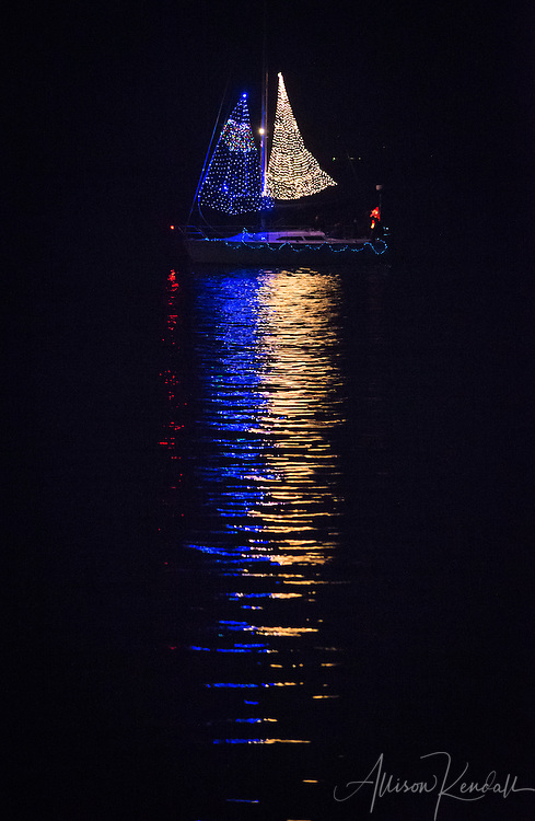 Scenes from the Monterey Lighted Boat Parade, celebrating the holiday season on the waters of Monterey bay and harbour.<br /> <br /> Prints: https://bit.ly/holiday-boat-reflection