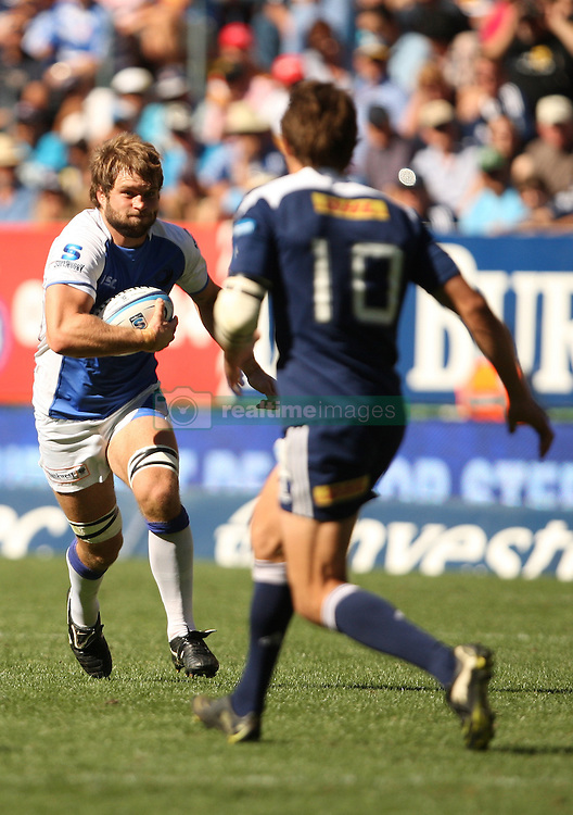 Ben McCalman on the attack with Peter Grant of the Stormers defending during the Super Rugby (Super 15) fixture between DHL Stormers and the The Force played at DHL Newlands in Cape Town, South Africa on 26 March 2011. Photo by Jacques Rossouw/SPORTZPICS