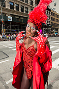 New York, NY - 25 June 2017. New York City Heritage of Pride March filled Fifth Avenue for hours with groups from the LGBT community and it's supporters. A man in bright red drag.