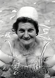 Portrait of an elderly woman swimming, Nottingham, UK 1991