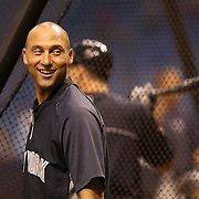 New York Yankees shortstop Derek Jeter (2) smiles as fans scream his name prior to a major league baseball game between the New York Yankees and the Tampa Bay Rays at Tropicana Field on Thursday, Sept. 17, 2014 in St. Petersburg, Florida. (AP Photo/Alex Menendez)
