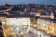 Lisbon's Dom Pedro V Square, commonly named Rossio, seen from Santa Justa lift lookout at twilight.