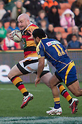 Brendon Leonard push's off Buxton Popoalii on the way to scoring a try during the Round 9 ITM cup Rugby match, Waikato v Otago, at Waikato Stadium, Hamilton, New Zealand, Sunday 13 August  2011. Photo: Dion Mellow/photosport.co.nz