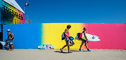 September 6, 2017 - San Clemente, California, USA - Surfers walk past a colorful wall as the the top women surfers in the world surf at the Swatch Pro held at Lower Trestles at San Onofre State Beach south of San Clemente on Wednesday, August 6, 2017. (Photo by Mark Rightmire, Orange County Register/SCNG) (Credit Image: © Mark Rightmire/The Orange County Register via ZUMA Wire)