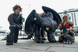 © Licensed to London News Pictures. 25/10/2019. LONDON, UK. People dressed as characters from the movie How To Train Your Dragon join other cosplayers from all over the world attending the opening day of the bi-annual MCM Comic Con event at the Excel Centre in Docklands.  The event celebrates popular culture such as video, games, manga and anime providing many attendees with the opportunity to dress up as their favourite characters.  Photo credit: Stephen Chung/LNP