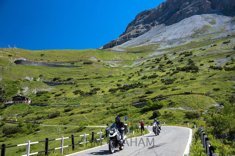 Motorcycles and walker on Stelvio Pass, Passo dello Stelvio, Stilfser Joch, on route Trafoi to Bormio, the Alps, Northern Italy