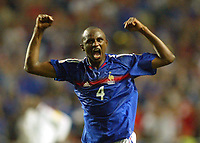 England v France - Estadio de Luz, Lisbon - 13th June 2004<br />France's Patrick Vieira celebrates toward the England fans on the final whistle after his team's come back<br />Photo: Jed Leicester/Sporting Pictures<br />© Sporting Pictures (UK) Ltd<br />www.sportingpictures.com<br />Tel: +44 (0)20 7405 4500<br />Fax: +44 (0)20 7831 7991