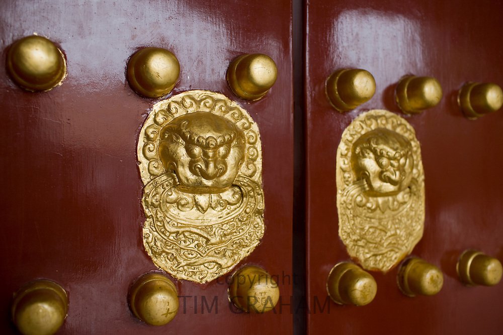 Nails and lion-head knockers on gate to Tower of Buddhist Incense at The Summer Palace, Beijing, China