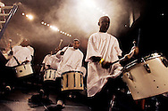 """Black Diamonds, a drum core, performing on stage..Battlezone 2005 held at the Great Western Forum in Inglewood, CA. Krumpers and Clown dancers from South Central LA showcase their dancing skills in a yearly competition. Tommy Johnson, aka """"Tommy the Clown"""" started the Clown dance and Krumping movement in South Central LA as a real alternative to gangs and crime. The high energy Krumping and Clown dancing are hip hop based with African tribal dancing tributes. Face paint is often worn to distinguish the dancers unique dance styles, most are clown like with graffiti accents. The dance movement was made popular by the recent documentary """"Rize"""" by photographer David LaChappelle which featured """"Tommy The Clown"""".."""