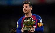 Lionel Messi of FC Barcelona holds up his sixth Ballon d'Or prior the sixteen round match of the La Liga 2019-2020 season between FC BARCELONA and RCD MALLORCA at CAMP NOU STADIUM in Barcelona, Spain.December 7, 2019